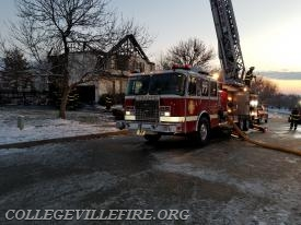 """Ladder 77 at the  """"A-B"""" side in front of fire building."""