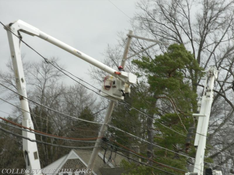 Electric Crew working by Hunsberger Woods straightening out a pole.
