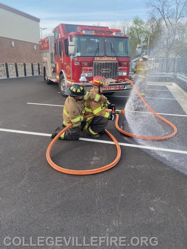 SD 34 @ Mulch Fire Royal Farms JR Fire fighter Eric Bowe Jr., backing him up Fire fighter Sam Ahola